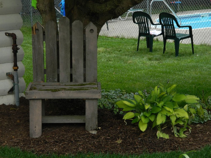 Unit 3 shaded sitting area flower bed
